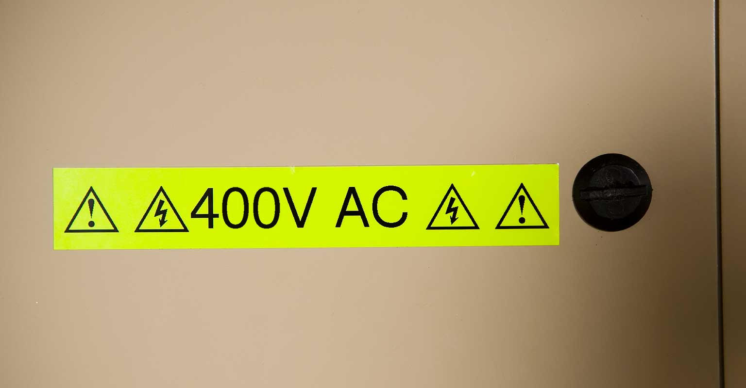 P-touch fluorescent TZe tape with voltage warning message