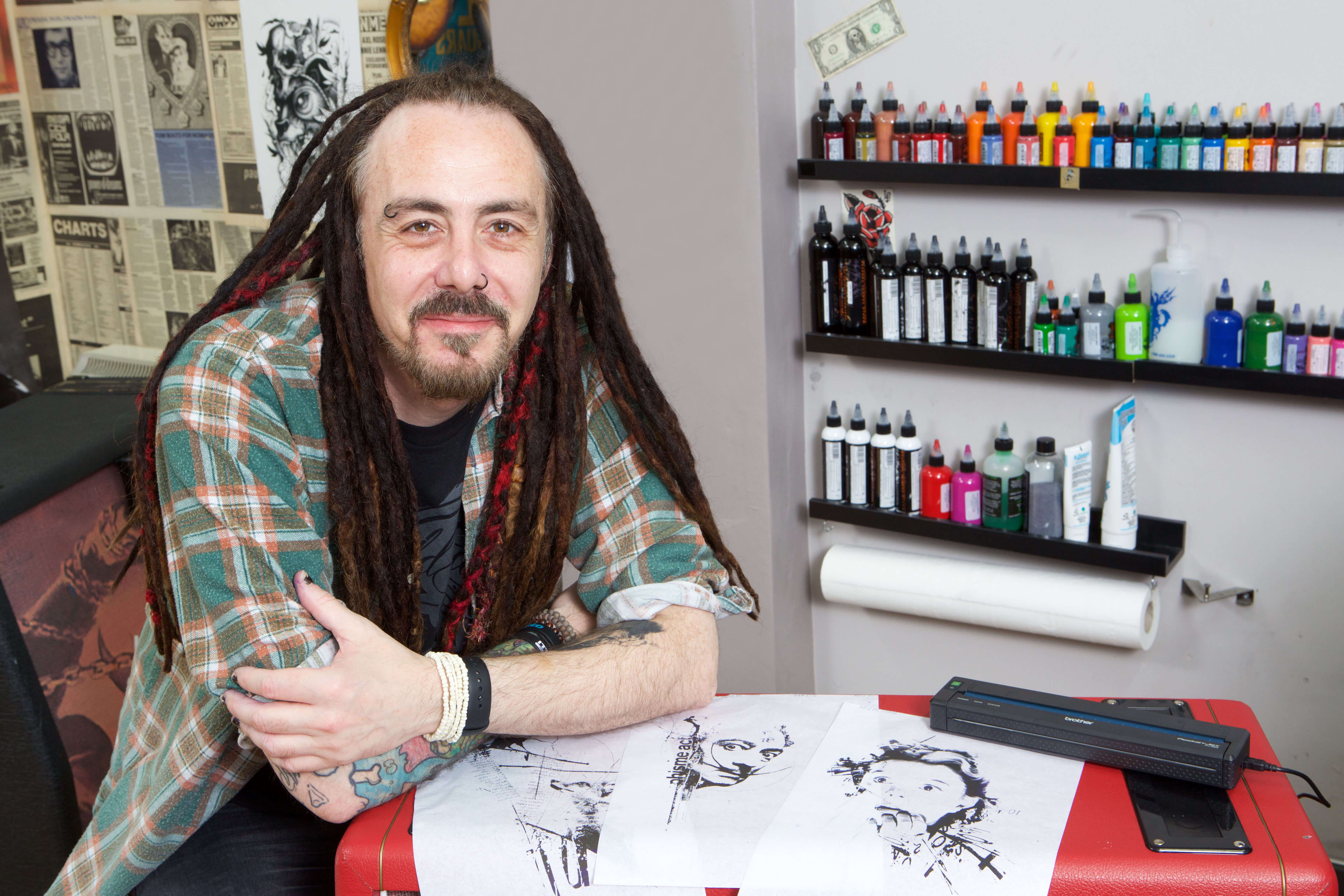 Tattoo artist Paul Talbot using Brother PJ7 device
