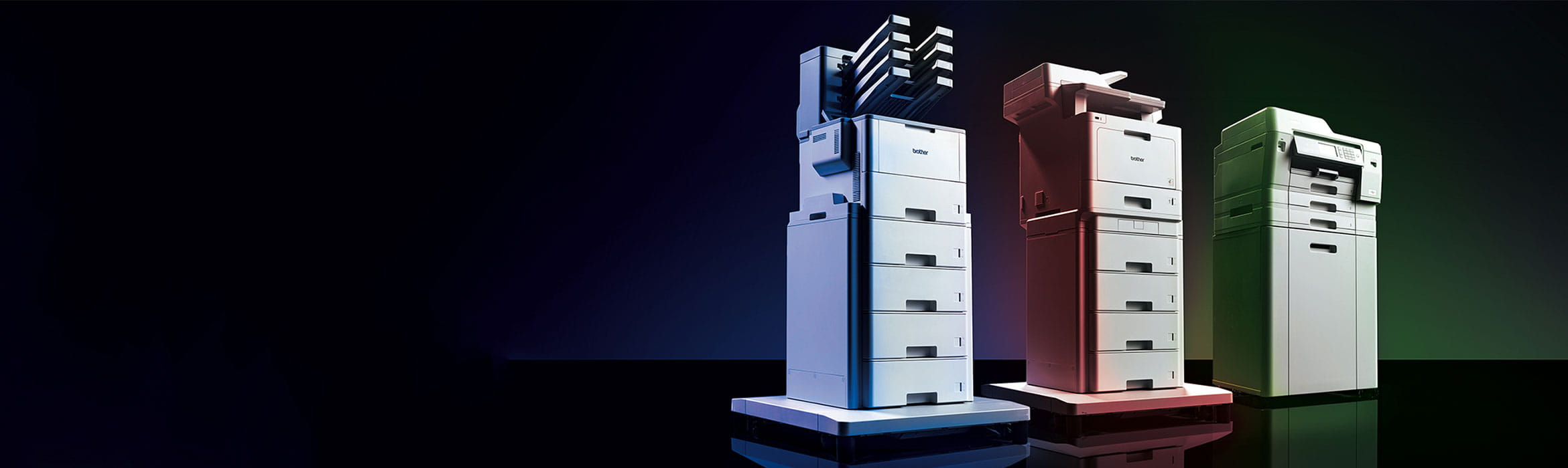 Brother HL-L9310CDW, MFC-L9570CDW and MFC-J6947DW professional printer range on black background with blue, red and green lighting.