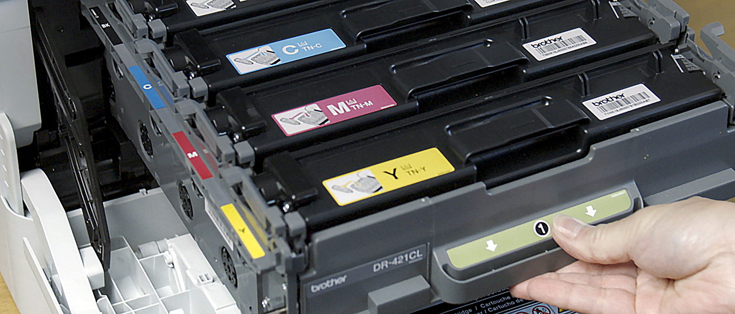 Person opening printer with toner cartridges