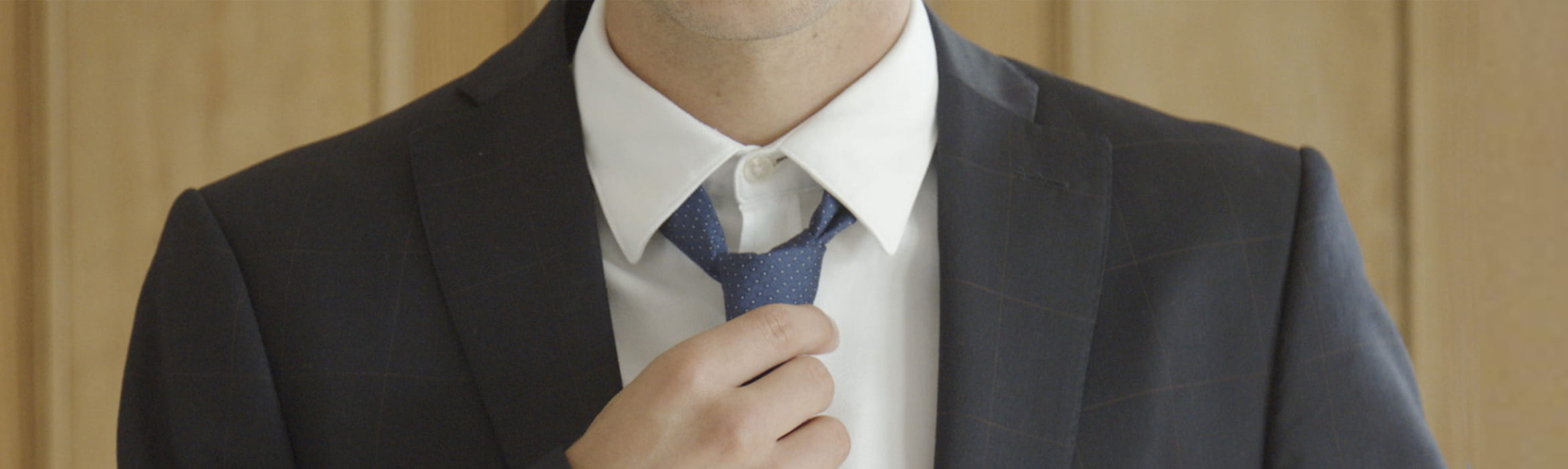 Man wearing a suit and tie