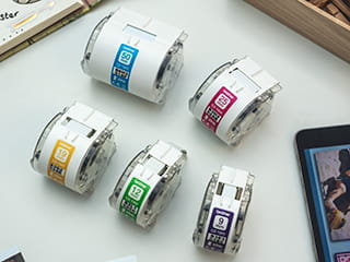 Five Brother label cassettes of various widths for the Brother Design and Craft label printer