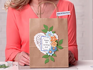 A personalised gift bag using printed labels created on the full colour Brother Design and Craft label printer
