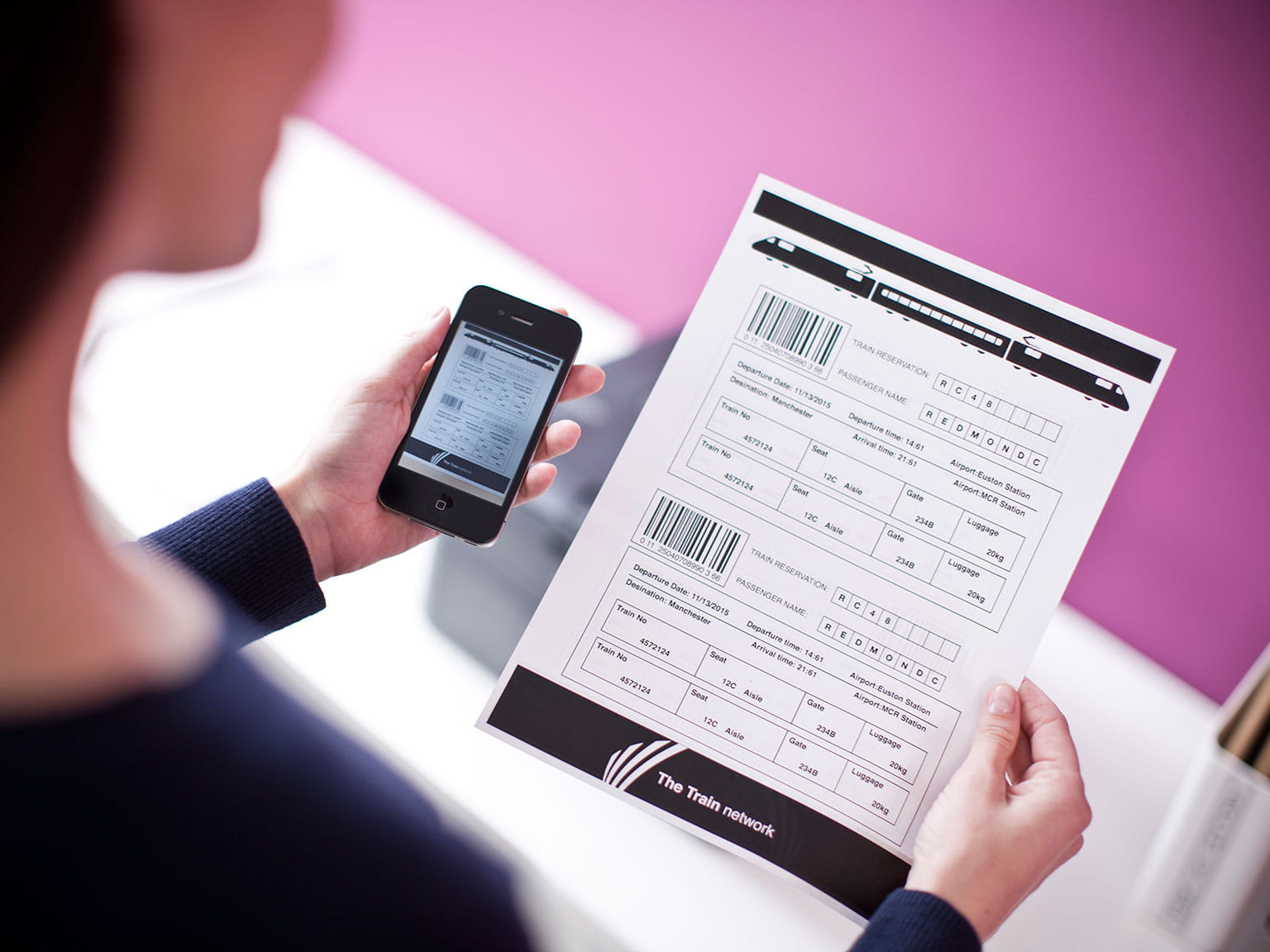 iphone held next to a document